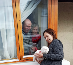 Rebecca Glynn introduces her parents, John and Marie Fogden, to their new granddaughter, Adah