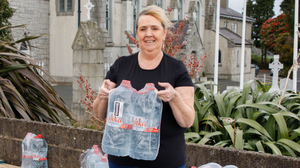Theresa Byrne with the bottled water being supplied in Barndarrig