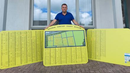 Cllr Paul O'Brien with the newly delivered signs and maps.