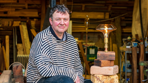Eoin Shanley at the entrance to his studio with his Forager lamp on some unfinished bases. PHOTOS BY LEIGH ANDERSON