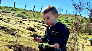 Leo Ward helps with the tree planting
