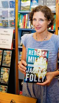 Author Rebecca Miller with her book Jacob's Folly at her book signing in Bridge Street Books Wicklow