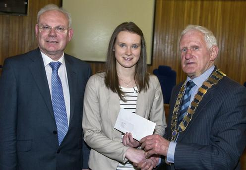 Wicklow Manager Eddie Sheehy and Co Chairman Cllr Jimmy O'Shaughnessy present former Avondale Community College student Laura Kavanagh with the first ever Katie Taylor Bursary award.