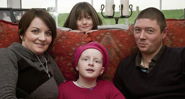 Chloe McCall (11), with parents, Lisa and Keith, and younger sister Julia. Picture: Garry O'Neill