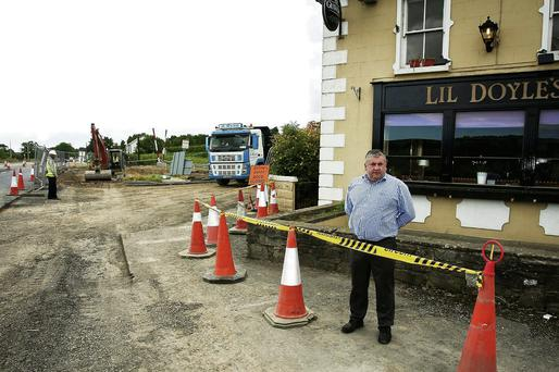 Jack Traynor outside his pub beside the N11.