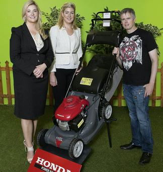 Jenny Reynolds, General Manager, Honda Ireland joins Arlene Regan, Marketing and Promotions Manager, Irish Independent and lucky winner Dominic Plant from Blessington, Co Wicklow at Honda in the M50 Business Park, Ballymount in Dublin. Photo: Peter Houlihan