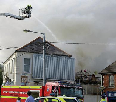 Fire-fighters tackling the blaze on Castle Street in Bray last Tuesday.