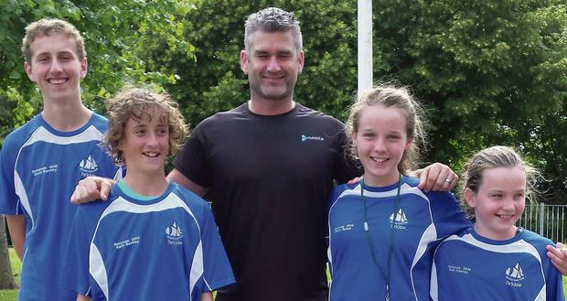 Asgard swimmers Gavin Bentley, Keith Bentley, Robyn Nuzum and Ellen Keaney with their coach John Kealy.