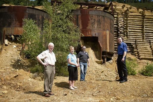 Avoca Mines committee, Pat Whelan, Marie Merrigan, Com Moore and Henry Alexander beside the Ore pots
