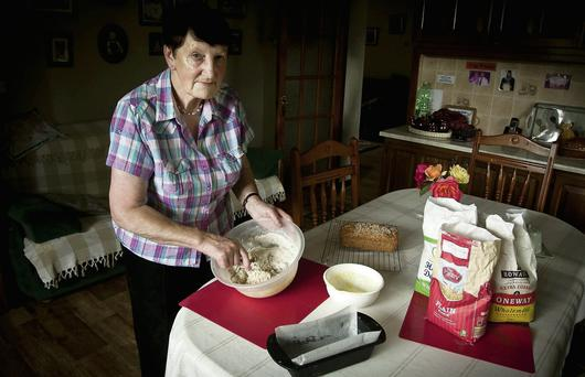 Statia Ivers making brown bread in her kitchen in Ballycoog