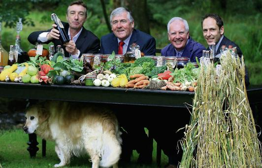 Evan Doyle (TASTE Council, Brooklodge Hotel); Minister of State at the Department of Agriculture, Food and the Marine, Mr. Tom Hayes TD; John McKenna (TASTE Council, McKenna's Guides); and Kevin Sheridan (TASTE Council chairman, Sheridans Cheesemongers) with Oscar the dog at the food summer school.