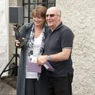 Eamonn Heffernan making a presentation to Rebecca Storm at the opening of the new Cruthu Premises at Russborough House