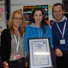 Rachael Doyle, Rathvilly Foróige Club Carlow (17) accepts a Certificate of Achievement from Miriam Ryan, Foróige Area Manager Blanchardstown, and Paul Scully, Buying Director, Aldi Ireland, at the Foróige Youth Citizenship Awards in partnership with Aldi Ireland. Rachael was also honoured with a 'One to Watch' prize