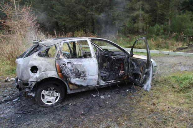 The remains of the burnt out car, which was found on Monday near Tinahely