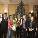 Audrey Hudson makes a presentation to Liz Doyle to mark 20 years service working in the Arklow Bay Hotel