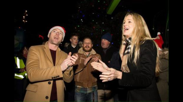 Ronan and Storm Keating lead the Christmas carols for the homeless