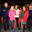 Megan Swaine and her mum Ashleigh making the presentation to Ciaran Doyle, Mary De Courcy and John Hayden at Wicklow Lifeboat Station