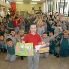 Pupils at Scoil Naisiunta Phadraig Naofa cheer on their classmate Katie Tuke who has been recognised as one of Ireland's best young painters