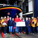Leinster Open Swim members Gus Cooney, Mary Aldridge, Cathy Cooney and Anne Hutson delivering their cheque to Wicklow RNLI crew and fundraising branch members (Photo: Wicklow RNLI)