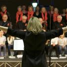 Wicklow Sings choral festival at Templecarrig School Greystones: Dara McMahon raises the roof for the end of the whole hall singing 'Something Inside So Strong'