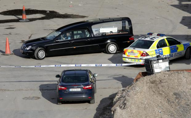The body is removed from the scene in a small, white coffin