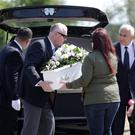 Gardaí carry the tiny coffin from the hearse to baby Alannah's final resting place