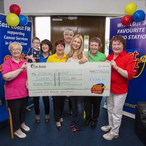 Founder Claire Darmody hands over the cheque to representatives of the cancer support centres