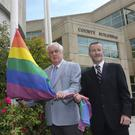 Co Council Chairman Cllr Pat Fitzgerald and CEO Brian Doyle raise the Rainbow flag at Co Buildings, Wicklow