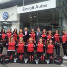 The touring party receive their jerseys from Sinnotts Auto and Carzone
