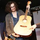 Special guest Hozier presenting the family with a signed guitar