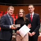 Former East Glendalough student Catherine Power (who now studies at Trinity College Dublin) with sponsor JP McManus and Minister of State for Tourism and Sport, Patrick O'Donovan