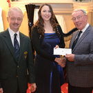 Siofra Ni Dhubhghaill receives her cheque from Eamon Sheridan and Noel Geragherty of Wicklow Male Voice Choir