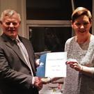 Ashleigh receiving her certificate from head judge John Conlon