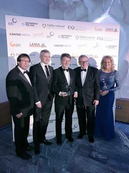 District Manager Des O'Brien (centre) and District Administrator David Forde (to his right) accept award from organisers