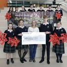 Coláiste Chill Mhantáin's German Market presenting €500 to Wicklow Hospice: Sinéad Tarmey accepts the cheque from Chloe Doyle, Mair Katharina, Gary O'Connor and Kayleigh Clare-Malone