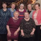 Twins Dina Newsome (seated left) and Nora Byrne (seated right) at their 70th birthday in Jacob's Well. At the back (left to right) are Pauline Kennedy, Mary Turner, Anne Hanlon, May Kennedy and Kitty Byrne