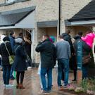 House-hunters queue in the bitter cold to view new homes in Portmarnock, Co. Dublin