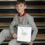 Avoca NS pupil Brian O'Hara with his certificate