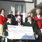 Members of Bray Harriers present a cheque to Bob Hawkshaw (front, middle) of Temple Street Hospital