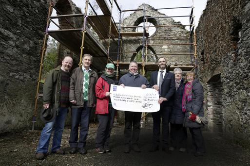Darren Mooney (third from right) presents a cheque for €3,650 to Newtownmountkennedy Tidy Towns for the stabilisation of Kilmurray Church with (L-R) Huw O'Toole, Robert Byrne, Grace Garde, Paul Kavanagh, Anne Martin, and Silvia O'Toole