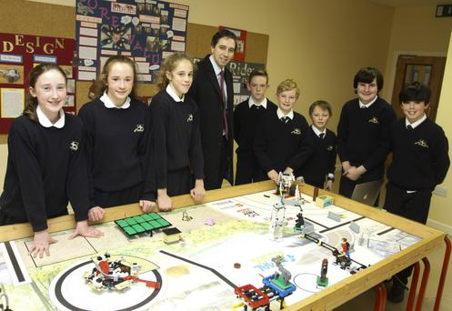Minister for Health Simon Harris with the National Lego robotic champions 'Robo Riders' – Lucy Doherty, Ciaran Nolan, Ava Paris Neiland, Luke Fitzpatrick, Charlie Clarke, Daniel Walton, Callum O'Reilly and Michael Mooney – at Wicklow Montessori School