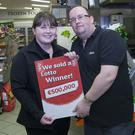 Staff members Aine Byrne and Damien Kenny celebrate selling the €500,000-winning Euromillions ticket in O'Reilly's Londis store in Hackets town last Friday