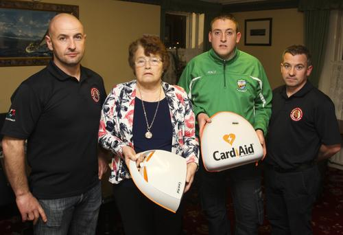 Arklow Asthma society chairperson Doreen Forde presents Arklow Cetlic's Mark Doyle with a defibrillator with John Summers and Brian Higgins from Arklow Community First Responders