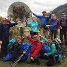 Members of the Glenwalk Hillwalking Group with one of the more surprising finds during their recent PURE clean-up in the mountains of Glenmalure and Barravore.