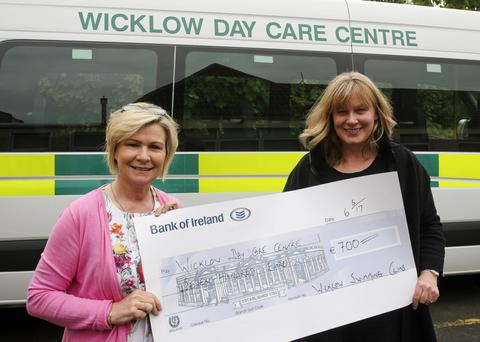 Mary Kinsella from Wicklow Day Care Centre is presented with the cheque by Jane O'Neill from Wicklow Swimming Club.
