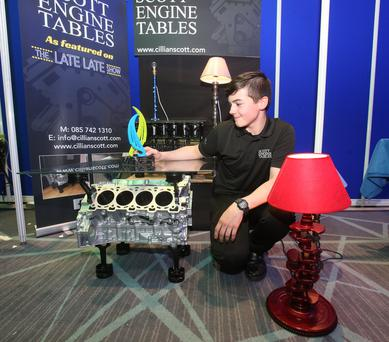 Colaiste Chill Mhantain student Cillian Scott with his intermediate award from the Student Enterprise Programme national final and some of his creations.