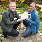 Ashford's John Durston (right) receives his gold medal for his 'Nature's Resurgence' show garden