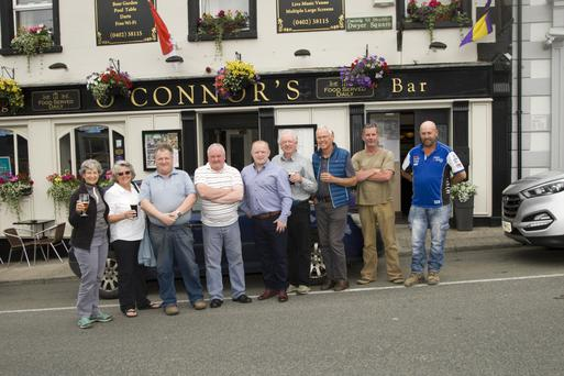 Darren Kavanagh (fifth from left) with some local customers and visitors from the US. Photo by Joe Byrne