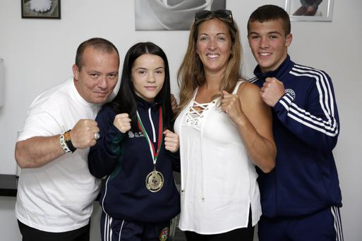 Daina Moorehouse with her dad John, mum Melissa and brother Michael