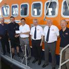 Mark Byrne presents €3,600 to Michael Mourdaunt and the Arklow RNLI fundraising committee from the Arklow RNLI golf classic
